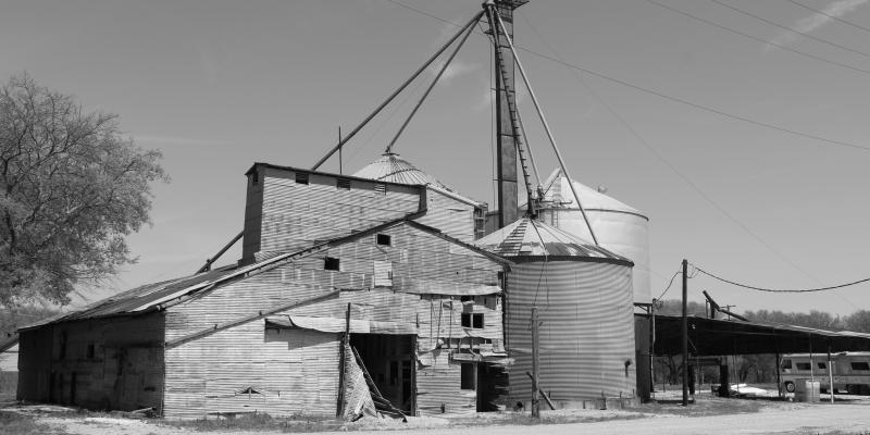Black and white photo of grain bins